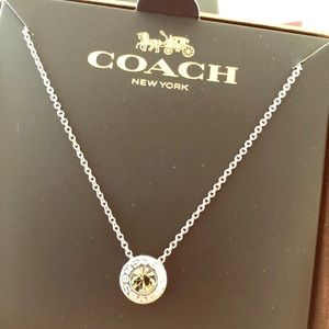 Beautiful coach necklace new